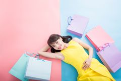 Woman take shopping bag. Happily on the blue and pink background royalty free stock photos