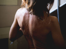Woman take a shower Stock Photography
