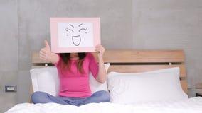 Woman take smile board Stock Photography