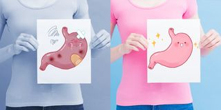 Woman take stomach billboard. With health concept on the blue background stock image