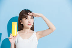 Woman take sunscreen Stock Photos