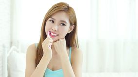 Woman take toothbrush. And smile happily at home Stock Image
