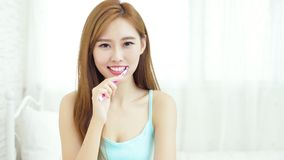 Woman take toothbrush. And smile happily at home Royalty Free Stock Images