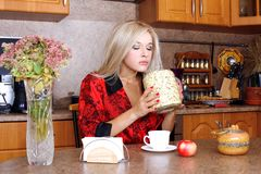 Woman taken jasmin petals for breakfast with apple Royalty Free Stock Image