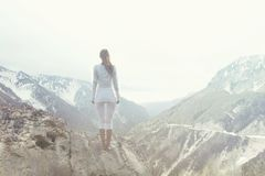 Woman taking a breath on the top of a mountain. Woman takes a breath on the top of a mountain Stock Image