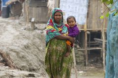 Woman takes care of her baby in Mongla, Bangladesh. Royalty Free Stock Photo