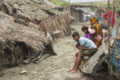 Woman takes care of her kids, Mongla, Bangladesh. Royalty Free Stock Images