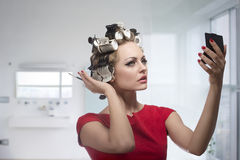 Woman takes care of her style Royalty Free Stock Photography