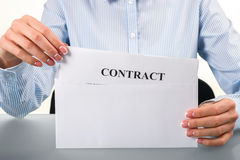 Woman takes contract from envelope. Stock Image