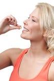 Woman takes drugs Stock Photo