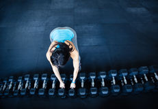 Woman takes a dumbbell. At gym Royalty Free Stock Photo