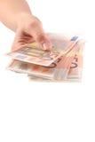 The woman takes the euro bill. On white Stock Image