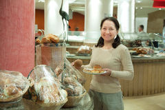 Woman takes fresh batch. On the table in buffet at hotel royalty free stock image