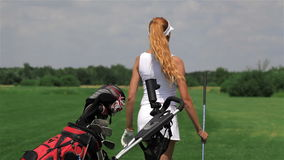 Woman takes a golf club stock video footage
