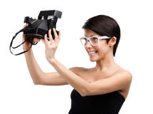 Woman takes images with amera Stock Images