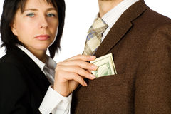A woman takes a money. Out of a man's pocket Royalty Free Stock Photo
