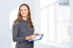 Woman takes notes Royalty Free Stock Photos