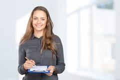 Woman takes notes Royalty Free Stock Photo