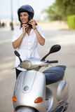 Woman takes off her helmet Royalty Free Stock Photo