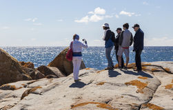 Woman takes photo of a family at Bingi Bingi point. NSW. Australia Royalty Free Stock Image