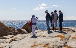 Woman takes photo of a family at Bingi Bingi point. NSW. Australia royalty free stock image