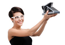 Woman takes photos with cassette camera Royalty Free Stock Photos