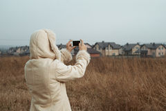 Woman takes photos of country town Royalty Free Stock Photo