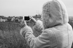 Woman takes photos of country town Royalty Free Stock Photos