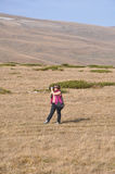 A woman takes photos in a mountainous area. Caucasian Nature Reserve. Russia Royalty Free Stock Photo