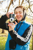 Woman takes a picture Royalty Free Stock Photography