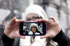 Woman takes picture of herself Royalty Free Stock Photo
