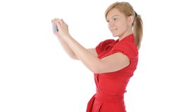 Woman takes a picture to your phone Royalty Free Stock Images