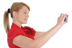 Woman takes a picture to your phone Stock Photo