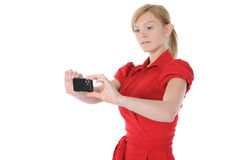 Woman takes a picture to your phone Royalty Free Stock Photos