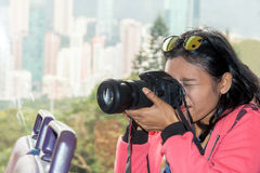 Woman takes pictures with camera in bus. A tourist is photographed on the road Stock Photo
