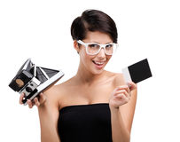 Woman takes pictures with cassette camera Stock Photos
