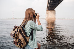 Woman takes pictures a concrete car bridge Stock Image
