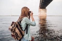 Woman takes pictures a concrete car bridge Stock Image