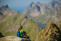 Woman takes rest on top of mountain in Norway Royalty Free Stock Photography