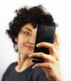 Woman takes a self portrait Stock Photography