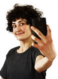 Woman takes a self portrait Stock Image