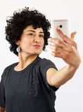Woman takes a self portrait Stock Photo