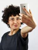 Woman takes a self portrait Stock Photos