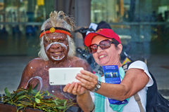Woman takes selfie with Australian Aborigine Stock Photo