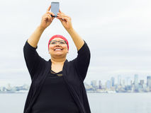 Woman Takes Selfie With Downtown Skyline In Background Stock Images