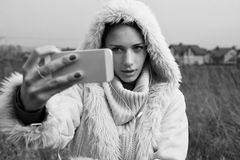 Woman takes selfies close up Stock Image