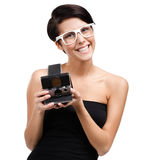 Woman takes shots with cassette photographic camera Royalty Free Stock Photos