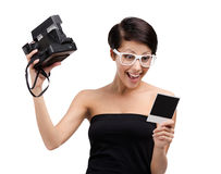 Woman takes snapshots with cassette camera Royalty Free Stock Images
