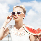 Woman takes watermelon. Concept of healthy and dieting food Stockbilder