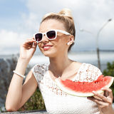 Woman takes watermelon. Concept of healthy and dieting food Stock Photos